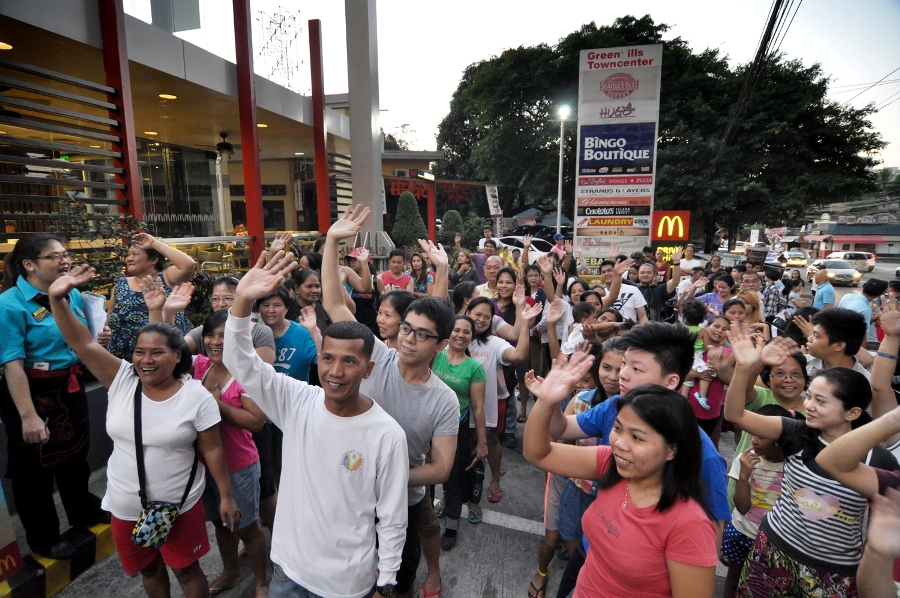 At 6AM, customers flock to participating McDonald's stores, ready to receive their delicious breakfast treat.